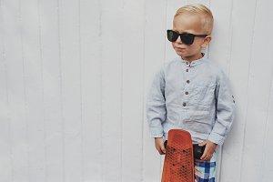 Trendy little boy posing