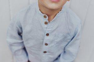 Fun little boy in trendy sunglasses