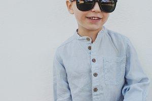 Little boy in big trendy sunglasses