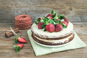 Rustic cake with cream and berries
