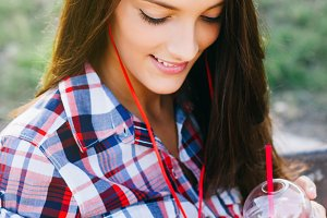 Girl drinking red smoothie