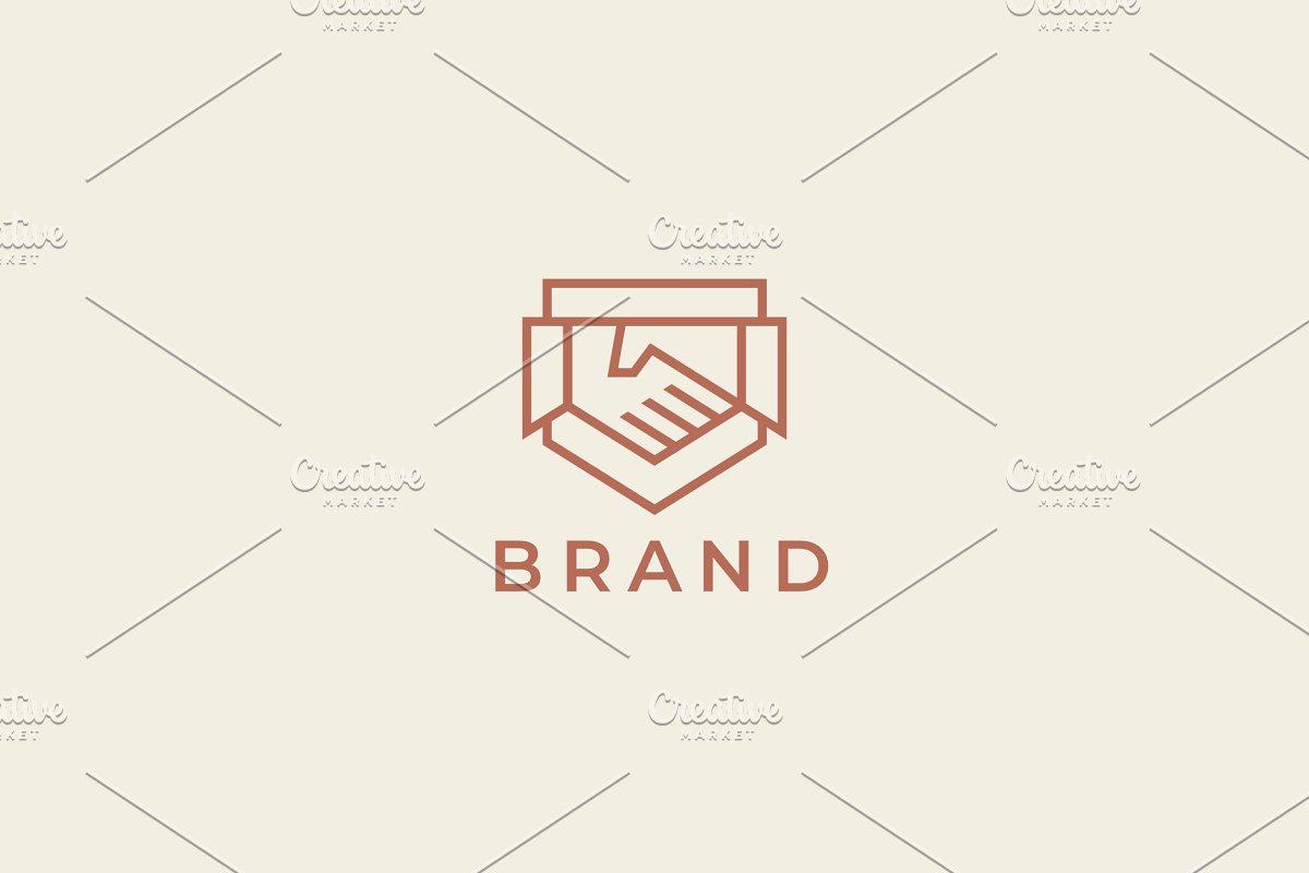 Abstract handshake business logo