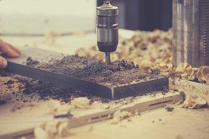 Machine drilling a hole