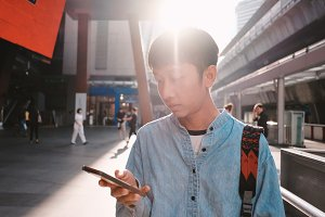 Young asian man using smartphone