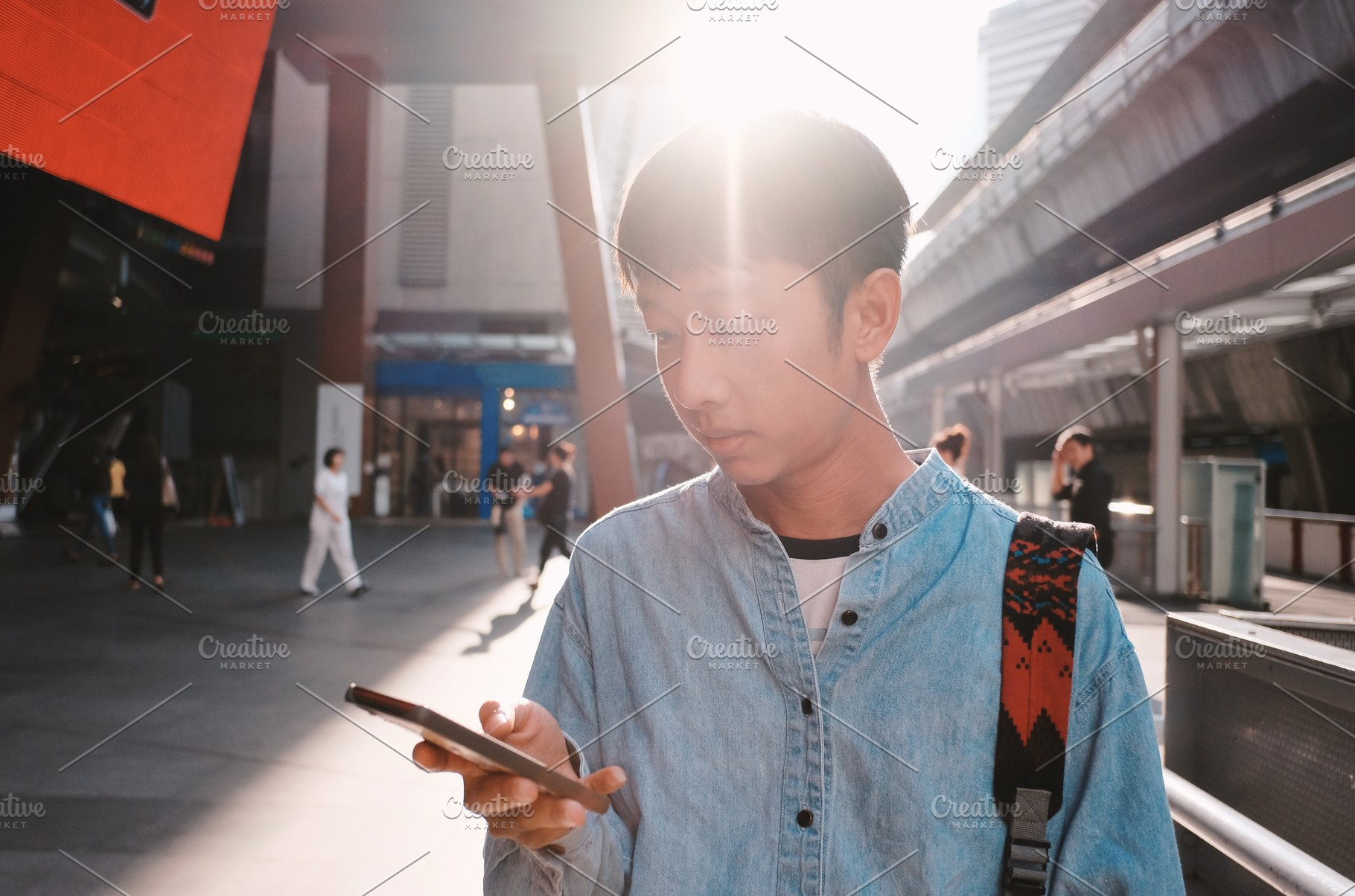 Young asian man using smartphone ~ People Photos ~ Creative Market