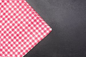 Checkered tablecloth on slate table