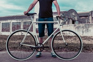 Young man with a fixie bike