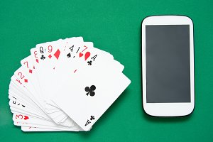 Poker cards and mobile phone