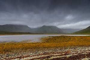 Lake and meadows in Skye island