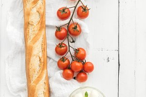 Baguette with brunch of tomatoes
