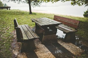 Picnic table and benches in a park