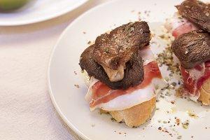 Mushrooms with cured ham