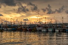 Fishing boats at sunset by  in Industrial
