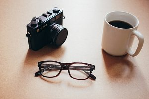 camera and eyeglasses with coffee