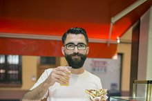 Hipster in pizza bar