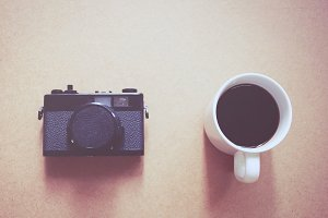 vintage film camera and coffee