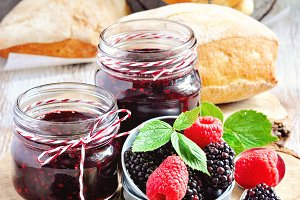 Fresh bread & homemade jam in jars