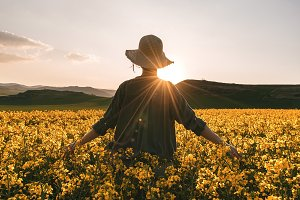 Unrecognizable woman among flowers