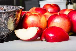Red apples on cutting board