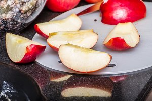 Red apples sliced for cooking