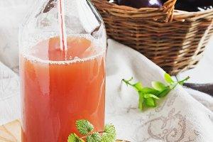 ripe plums and plum juice