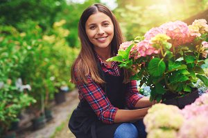 Smiling woman displaying a flower