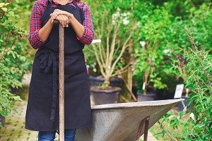 Woman transplanting nursery stock