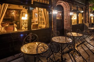 Night view of cozy restaurant in medieval old town of Bruges, Belgium