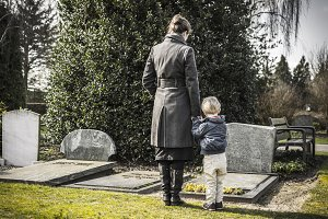 Mother and son at grave