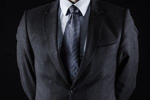 Businessman wearing Vendetta mask