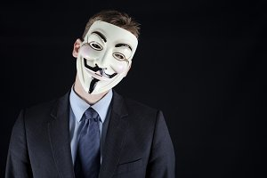 Man wearing vendetta mask