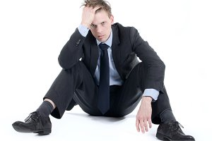 desperate businessman on floor