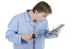 Man in pajamas reading bad news