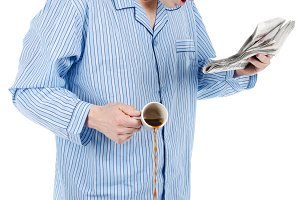 Man in pajamas with morning paper