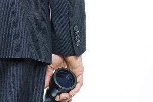 Businessman holding binocular