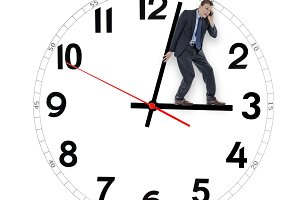Business man pushing clock