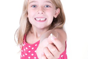 Girl showing first loose tooth