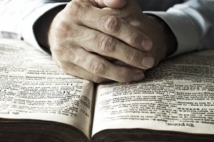 praying on the bible