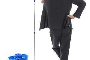 Businessman cleaning up mess