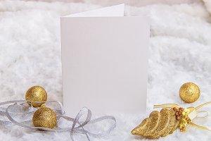 Mockup. White card, golden Christmas