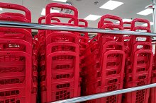 red piled baskets at supermarket by  in Industrial