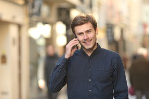 Man calling on the phone walking on the street.jpg