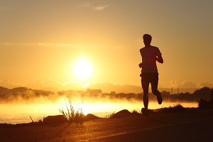 Silhouette of a man running at sunrise.jpg