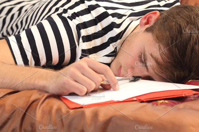 Tired student resting in his bedroom.jpg - Education