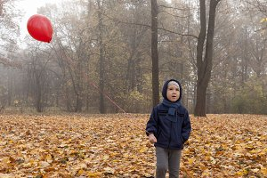 One little boy in the park with a re