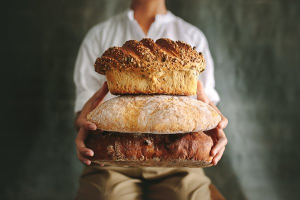 People Images: Jacob Lund - Baker showing various loaf breads