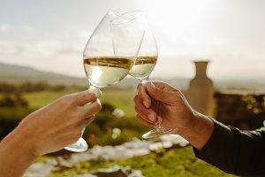 Couple toasting white wine