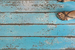 Feet on blue wooden background