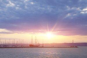 White yachts and beautiful sunset.
