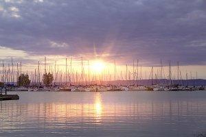 Many yachts and beautiful sunset.